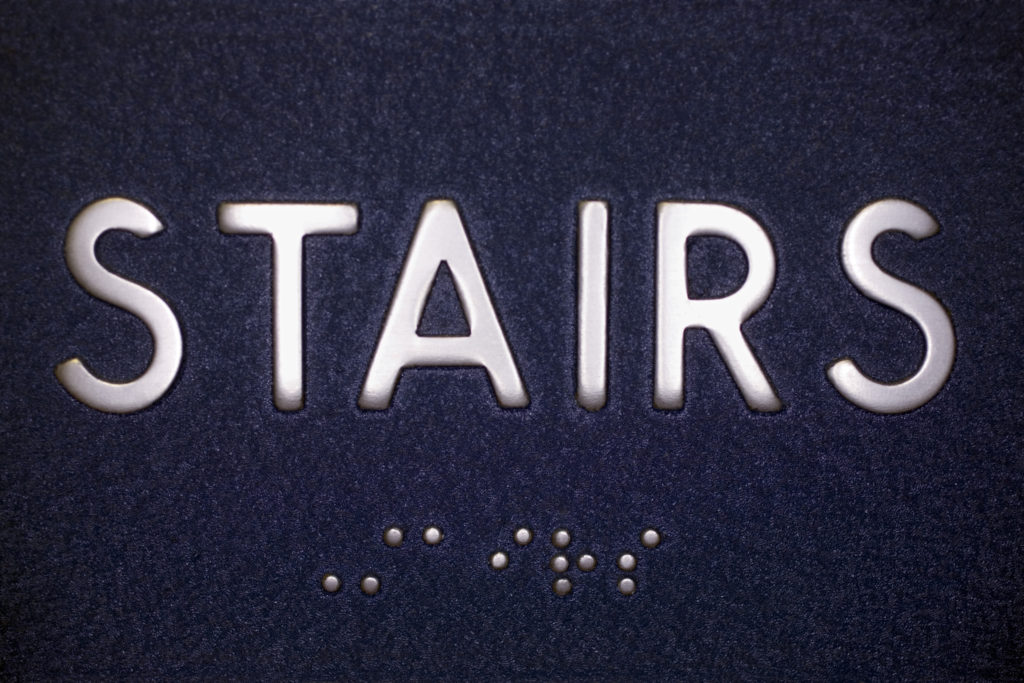 Digital Banners Plus makes ADA-compliance wayfinding signage for stairways