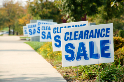 Digital Banners Plus makes yard signs for garage sales, auctions, and clearance sales like these