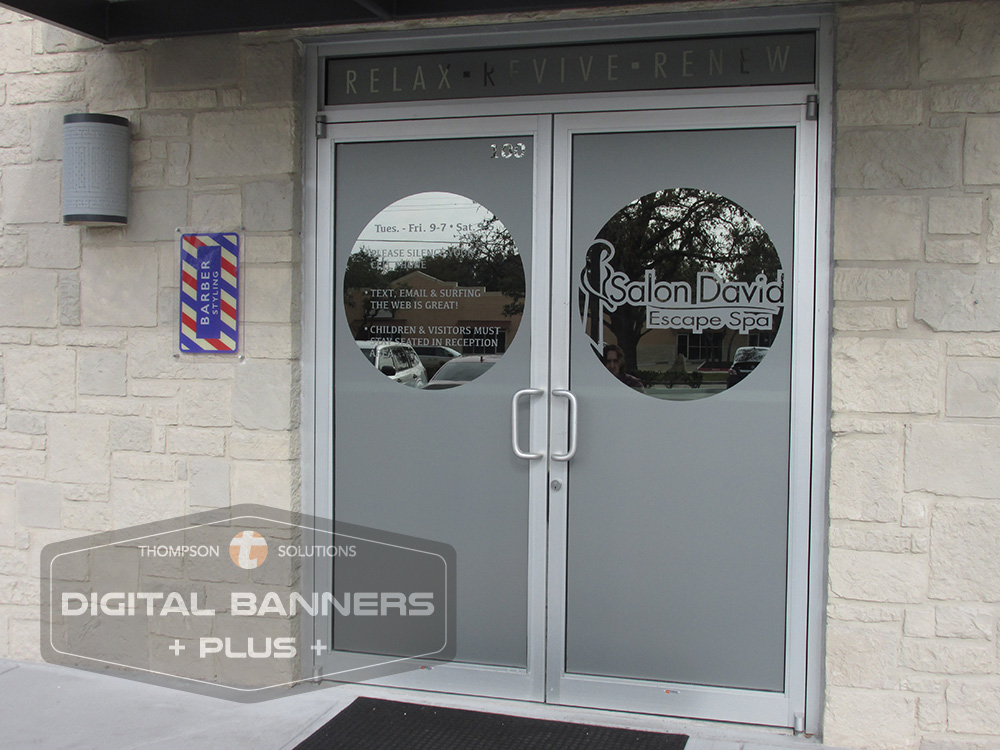 Plain glass doors are interesting and informational with privacy film, text and designs
