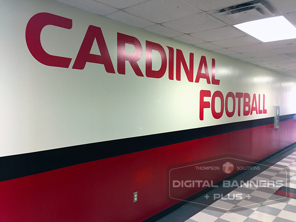 Large red vinyl lettering on a white wall can make a giant impact.