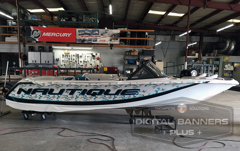 White speedboat with blue wrap